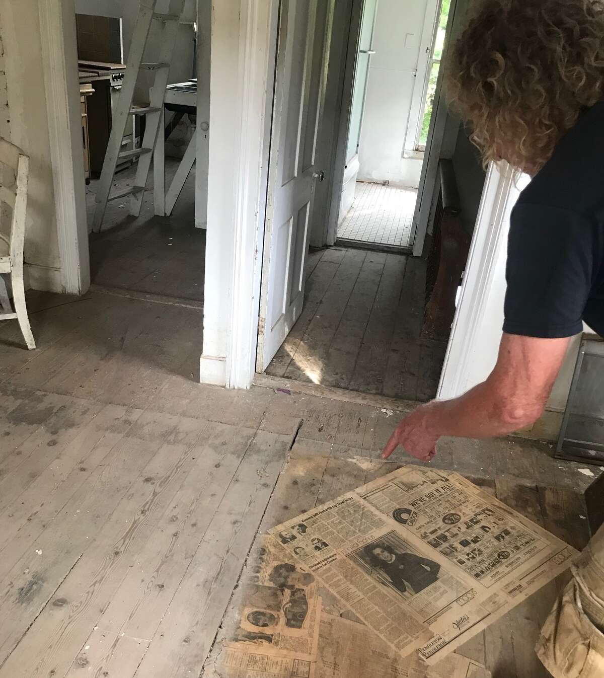 Inside Frank Cuthbert's new project in Athens, with some old newspapers including he had just found under a sheet of linoleum.