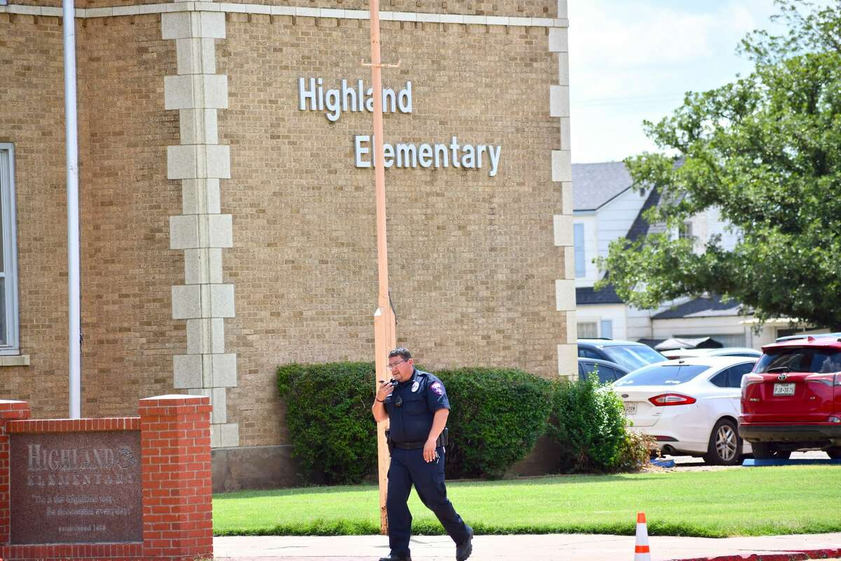 A Plainview ISD officer walks in front of Highland Elementary on Monday afternoon. A local law enforcement situation prompted the school to be placed into lockdown for about 15 minutes.