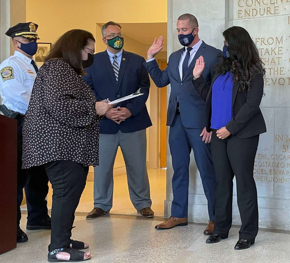 Beatriz Montijo has become first Hispanic woman in the town's history to make detective, and the first woman in over a decade to hold that rank. She is at far right; Town Clerk Vera Morrison, at left, did the swearing in.