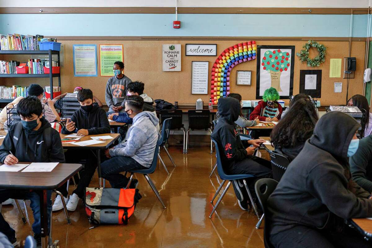 Students work in a classroom at Everett Middle School in San Francisco on the first day of in-person school for most students since March 16, 2020, due to the COVID pandemic.