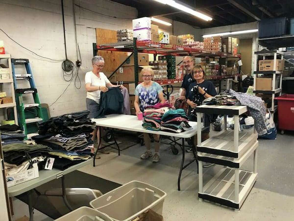 Volunteers at Hands of Grace food pantry and outreach, a ministry of St. Paul's Lutheran Church in New Hartford, show the donations they've received to help people displaced from their homes at the New Hartford House that was destroyed by fire Aug. 10.
