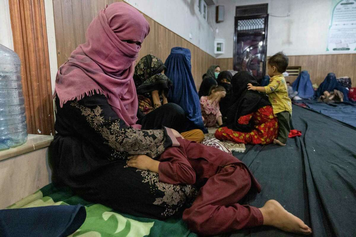 KABUL, AFGANISTAN - AUGUST 13 : Displaced Afghan women and children from Kunduz are seen at a mosque that is sheltering them on August 13, 2021 in Kabul, Afghanistan. Tensions are high as the Taliban advance on the capital city after taking Herat and the country's second-largest city Kandahar.