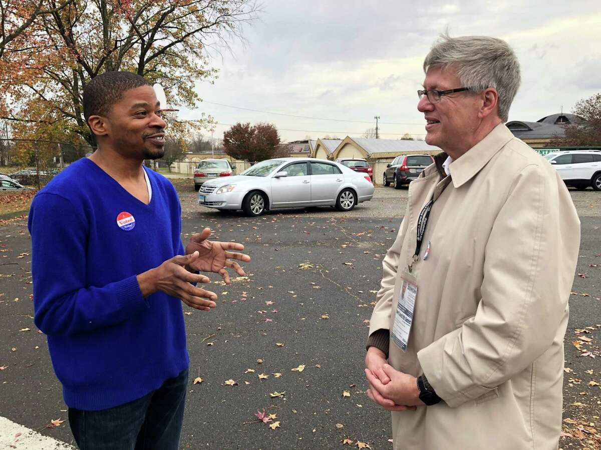 Stratford Democratic Town Council Member David Harden, left, talks with then-District 8 Democratic nominee James Simon outside Chapel Street School on Election Day, Nov. 5, 2019.