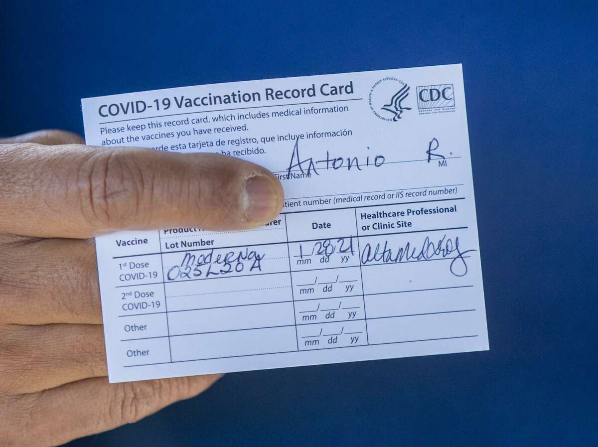 Former Los Angeles Mayor Antonio Villaraigosa holds his vaccination card after receiving his first shot of the Moderna COVID-19 vaccination in January 2021. (Allen J. Schaben/Los Angeles Times/TNS)