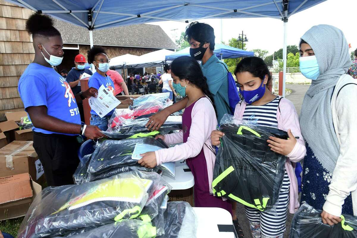 Children in the Khan family receive free backpacks at the New Haven Public Schools' Back To School Rally that also featured free school supplies at Bowen Field in New Haven on August 16, 2021.