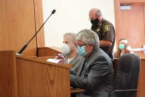 Josh Fortier (seated left), of Manistee,sits with his attorney, Mark Quinn,on Monday in 19th Circuit Court during sentencing. (Michelle Graves/News Advocate)