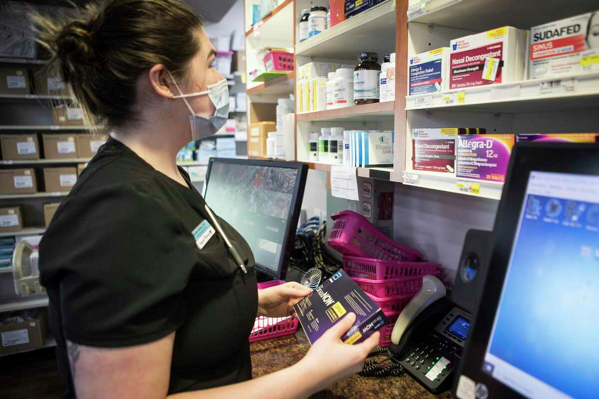 Ileana Geiser, certified pharmacy technician, returns a BinaxNOW COVID-19 Antigen self test to the shelf after a customer asked a question about the tests over the phone at Magnolia Pharmacy Monday, Aug. 16, 2021 in Magnolia. Demand for quick COVID-19 testing appeared to outpace supply in Houston last week as the delta variant spread rapidly. Testing slots at CVS and Walgreens were booked up several days out and you'd be lucky to find a store with any home testing kits left. Over-the-counter COVID-19 test kits are now the top-selling items. Manufacturers of BinaxNOW Self Tests said demand for its products is increasing as cases rise.