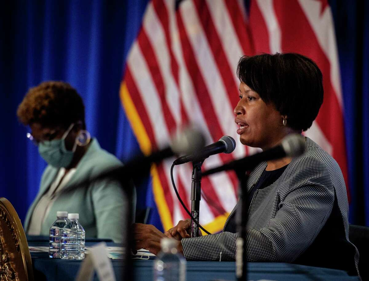 D.C. Democratic Mayor Muriel E. Bowser, right, holds a news conference on Aug. 16 to address the city's latest coronavirus policies.
