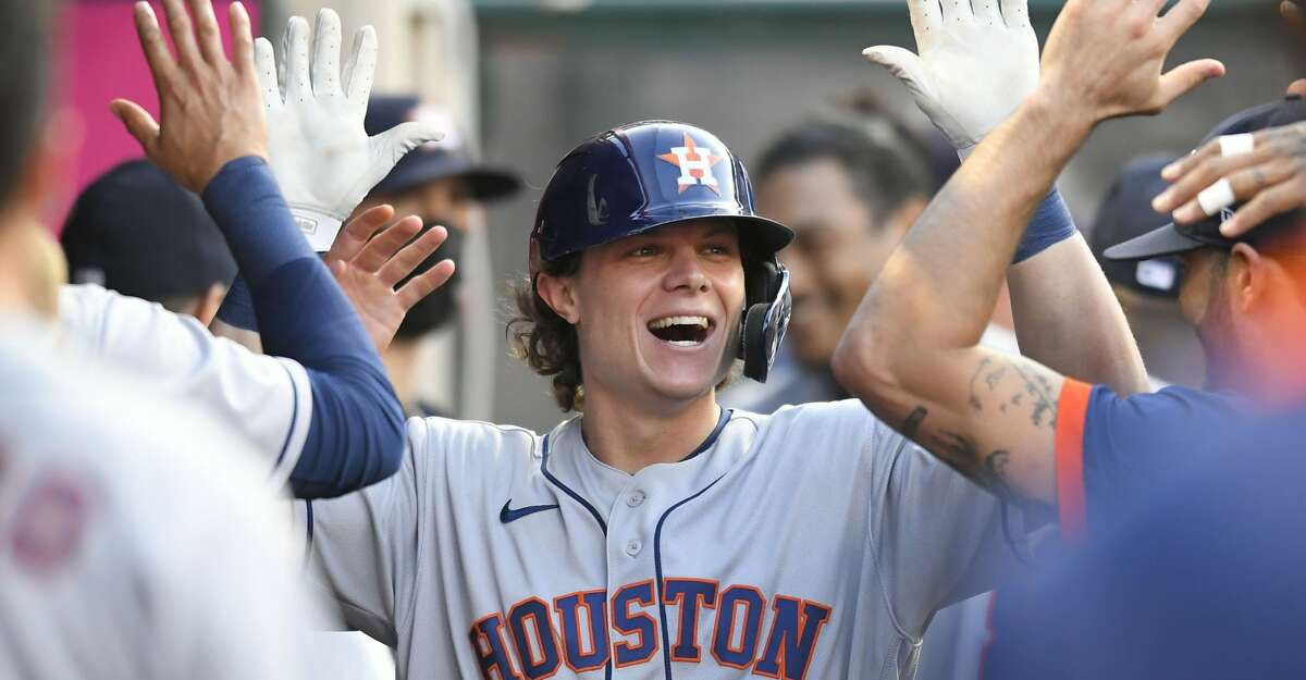 Houston Astros' Jake Meyers is congratulated for his home run in the third inning while playing the Los Angeles Angels in a baseball game Saturday, Aug 14, 2021, in Anaheim, Calif. (AP Photo/John McCoy)