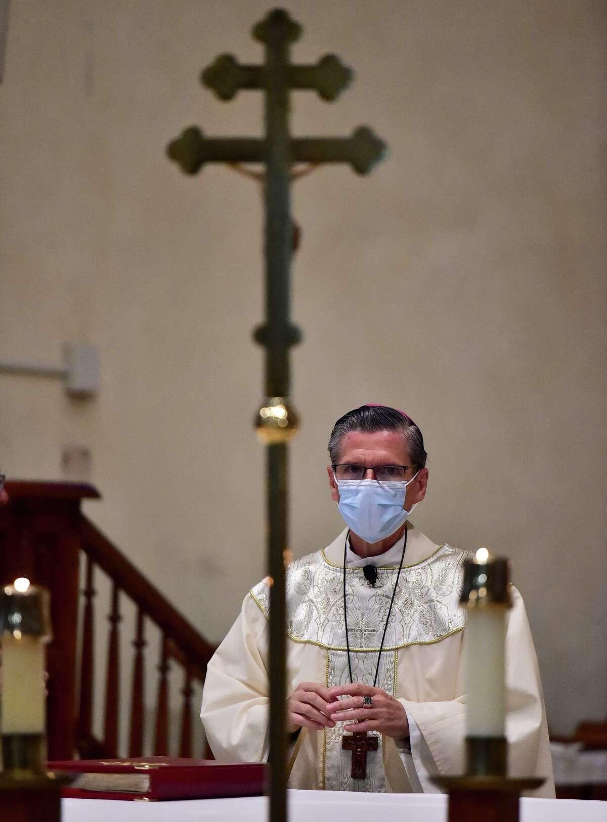 Archbishop Gustavo Garcia-Siller wears a mask during Sunday mass at San Fernando Cathedral.
