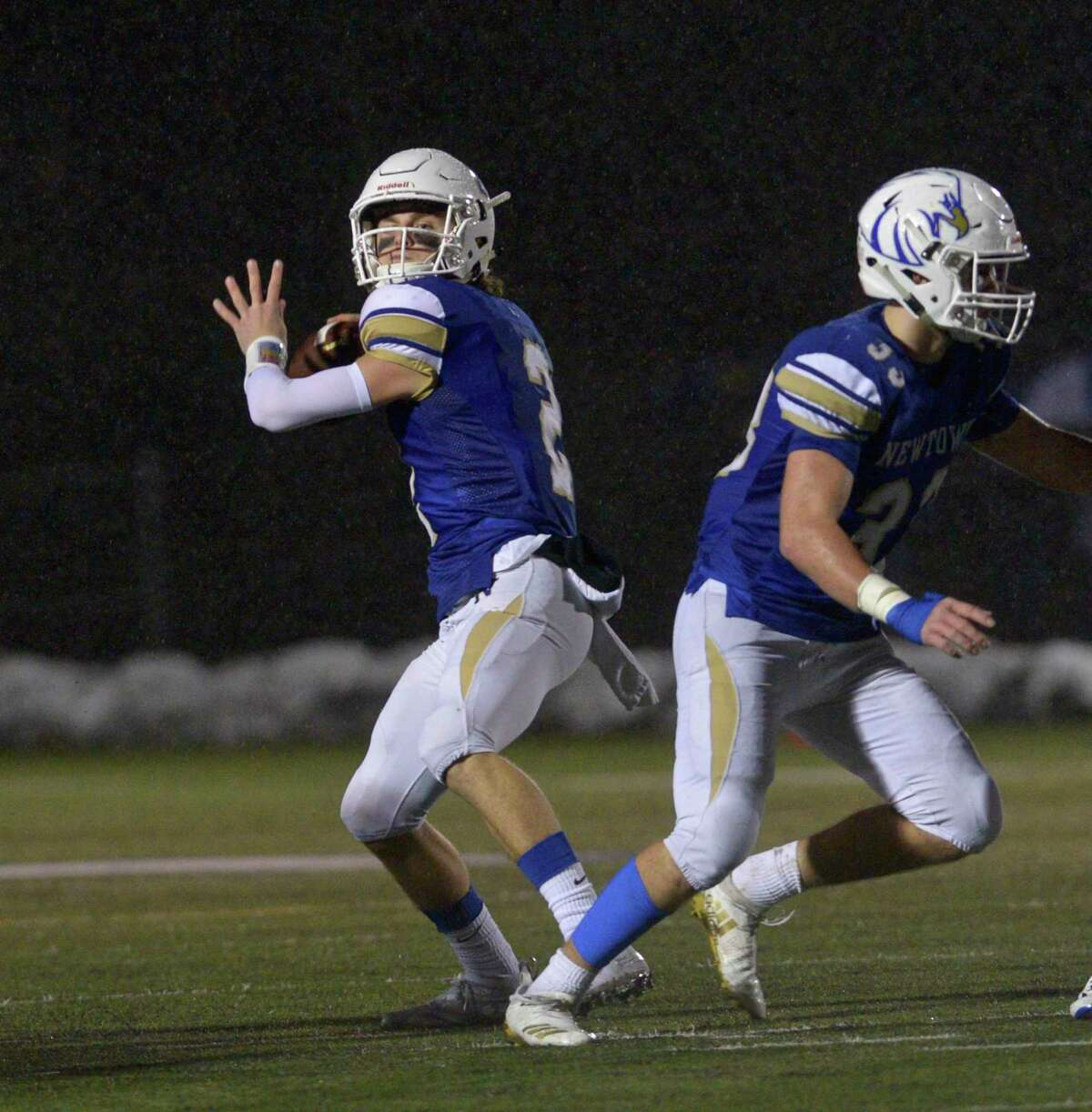 Newtown quarterback John Street looks to pass in the Class LL State Football semifinal game between No 4 Simsbury and No. 1 Newtown high schools, Monday December 9, 2019, at Newtown High School, Newtown, Conn.