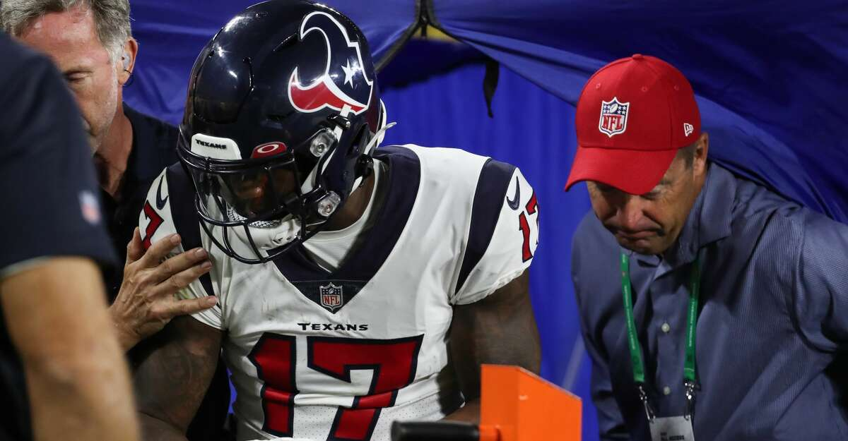 Houston Texans wide receiver Anthony Miller (17) leave the medical tent before being carted off the field after suffering and injury during the second half of an NFL pre-season football game Saturday, Aug. 14, 2021, in Green Bay, Wis.
