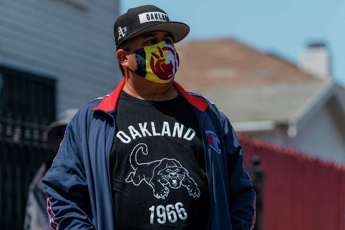 George Galvis, Executive Director of Communities United for Restorative Youth Justice is seen at a press conference held at the site of Erik Salgado's killing in Oakland, Calif., on Monday, August 16, 2021.