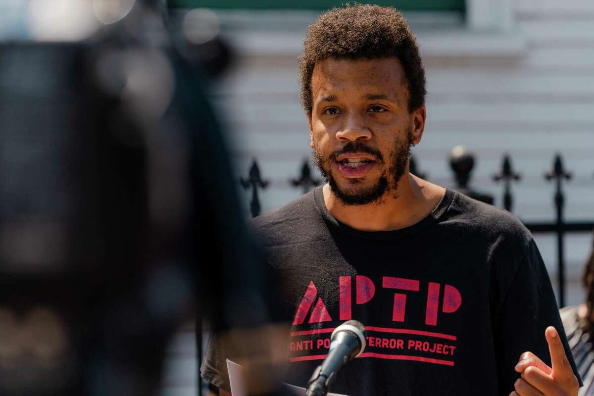 James Burch, Policy Director for the Anti Police-Terror Project, speaks at a press conference at the site of Erik Salgado's killing in Oakland, Calif., on August 16, 2021.
