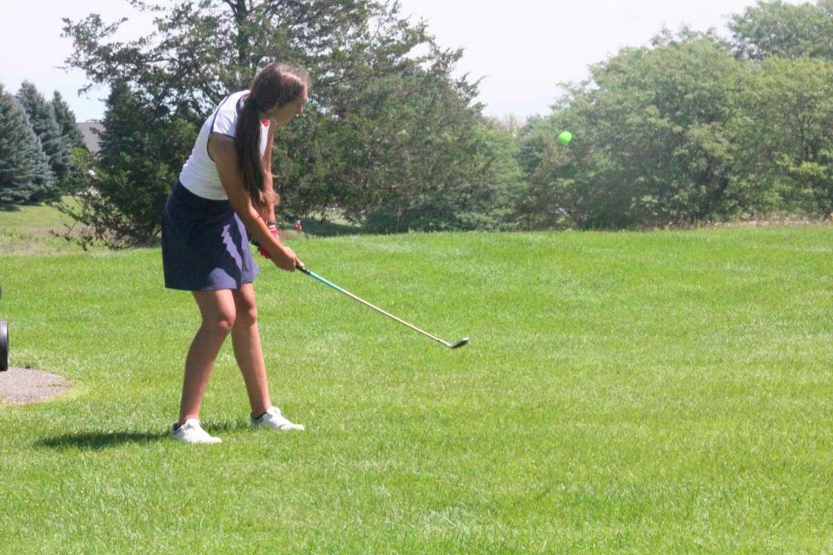 Big Rapids' Emmalynn Doering connects with hershot at Katke Golf Course on Monday. (Pioneer photo/John Raffel)