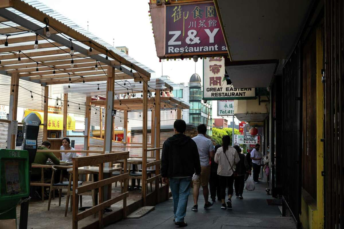 Pedistrians walk by noted Sichuan restaurant Z & Y in San Francisco's Chinatown. The restaurant has settled a $1.61 million wage theft case with 22 workers.