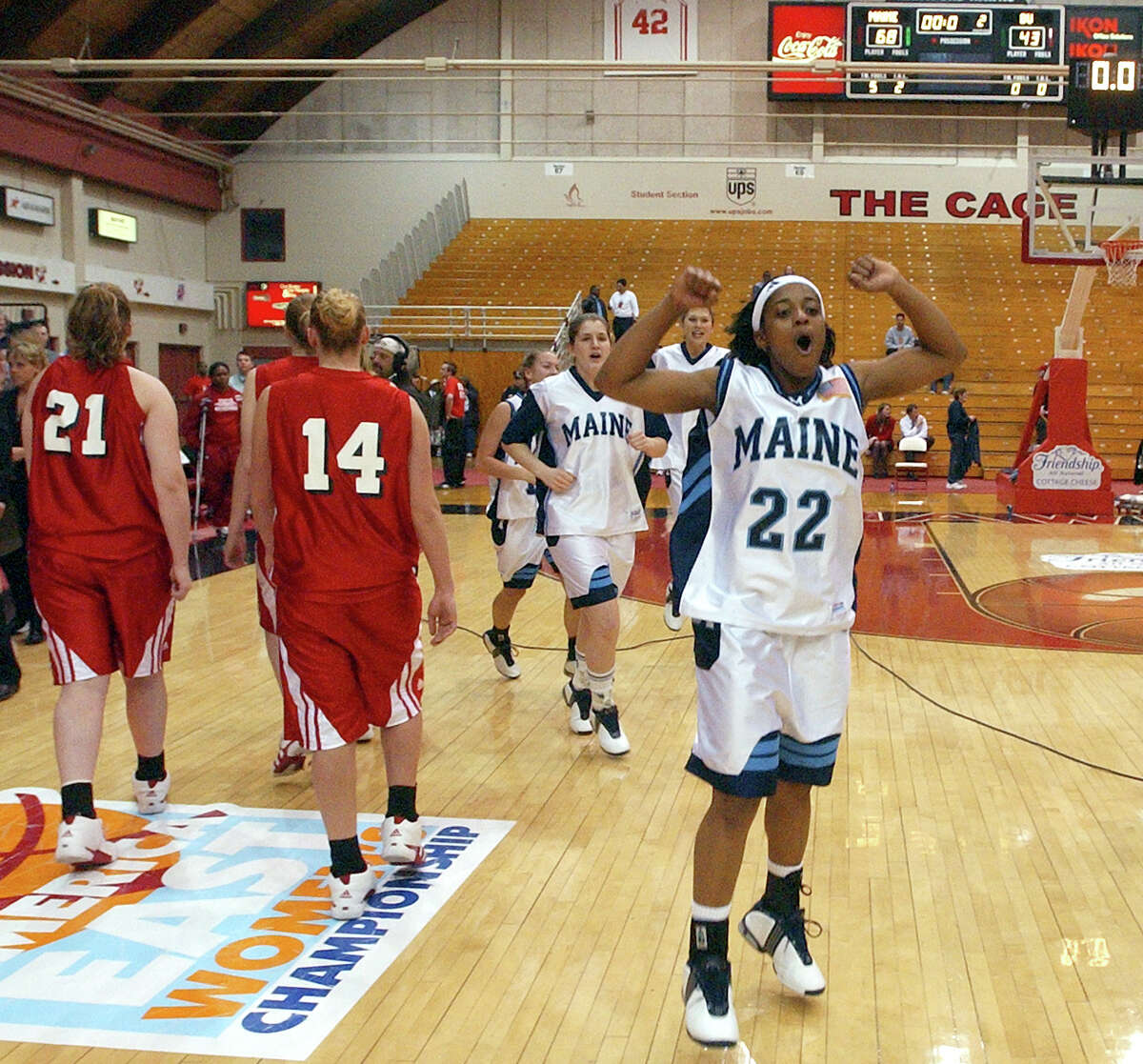 Maine's Kim Corbitt celebrates after Maine defeated Boston University 68-43 to win the women's America East Conference Tournament championship in 2004. Corbitt said the experience helped her prepare for where she is now.