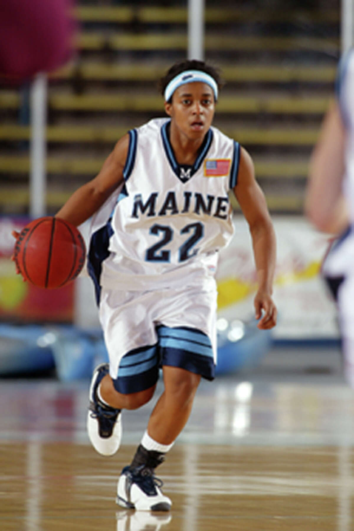 Kim Corbitt was a point guard at the University of Maine, and was America East Player of the Year as a senior. (Courtesy of Maine)