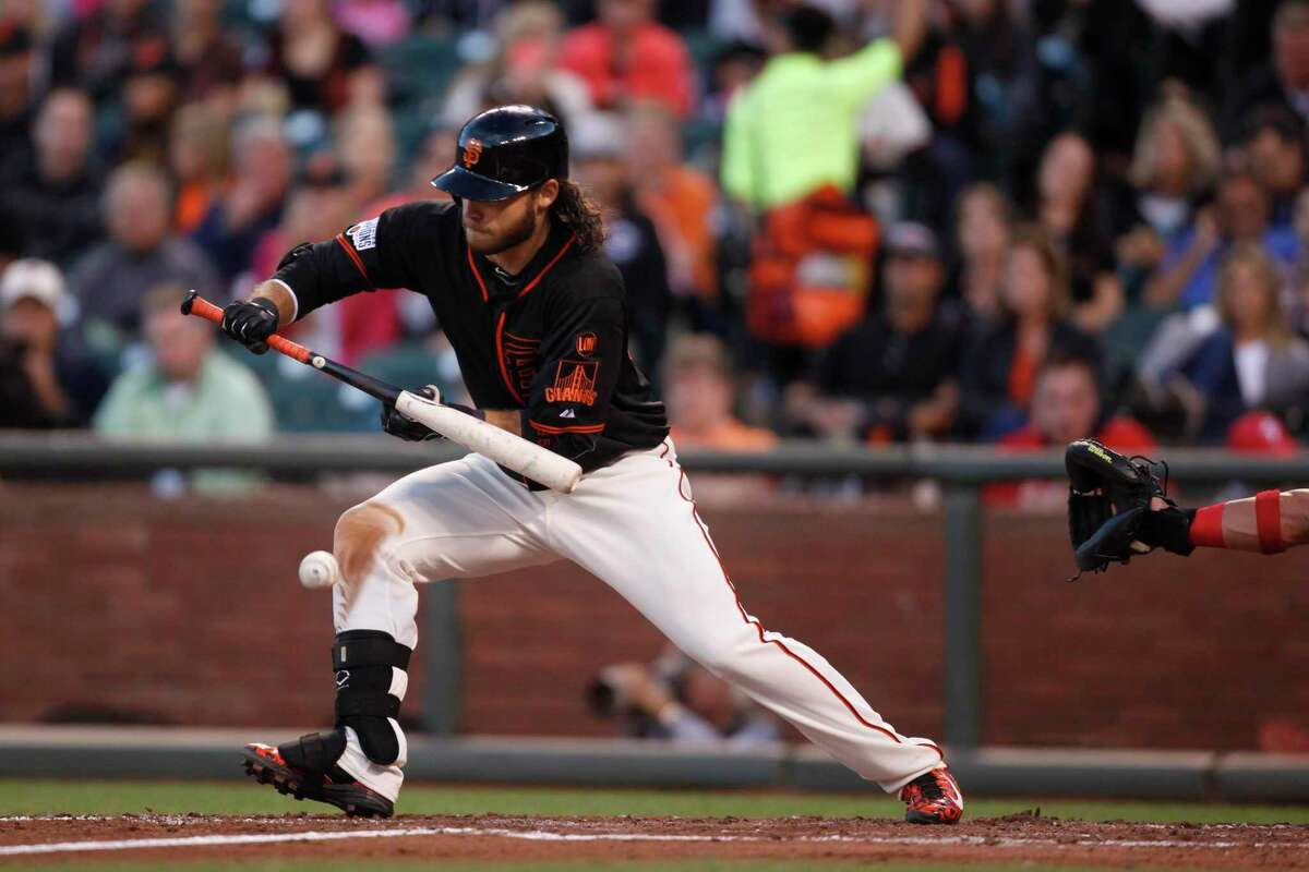 Brandon Crawford bunts his way to first base at the San Francisco Giants versus Philadelphia Phillies game at AT&T Park in San Francisco, California, on Saturday, July 11, 2015.