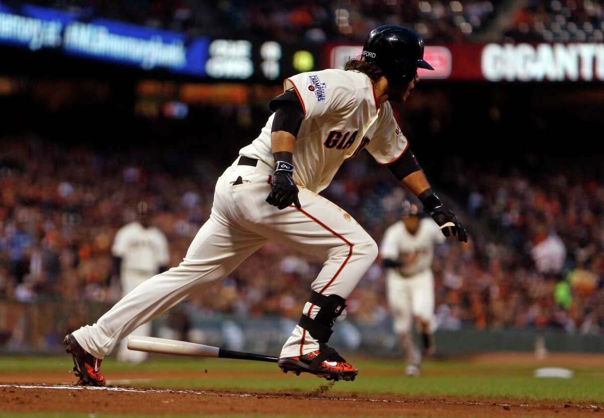 San Francisco Giants' Brandon Crawford bunts for an RBI with 2 outs in the 2nd inning against Los Angeles Dodgers during MLB game at AT&T Park in San Francisco, Calif., on Tuesday, April 21, 2015.