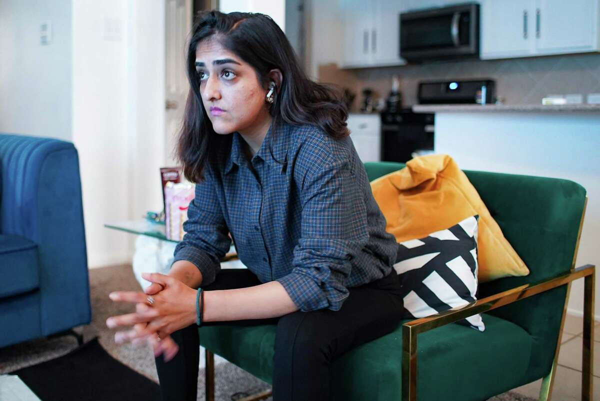 Sanya Wafeq, an Afghan native, watches Al Jazeera in her home in Richmond on Monday, Aug. 16, 2021. Wafeq left Afghanistan in 2015 and is trying to get her parents and siblings out.
