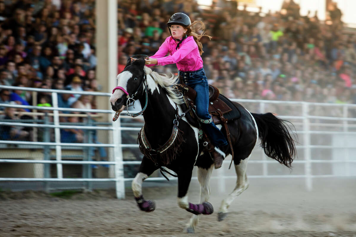 Aaliyah Pascoe of Tustin, 15, competes in barrel racing as hundreds of spectators attend the first night of the Super Kicker Rodeo Monday, Aug. 16, 2021 at the Midland County Fairgrounds. (Katy Kildee/kkildee@mdn.net)