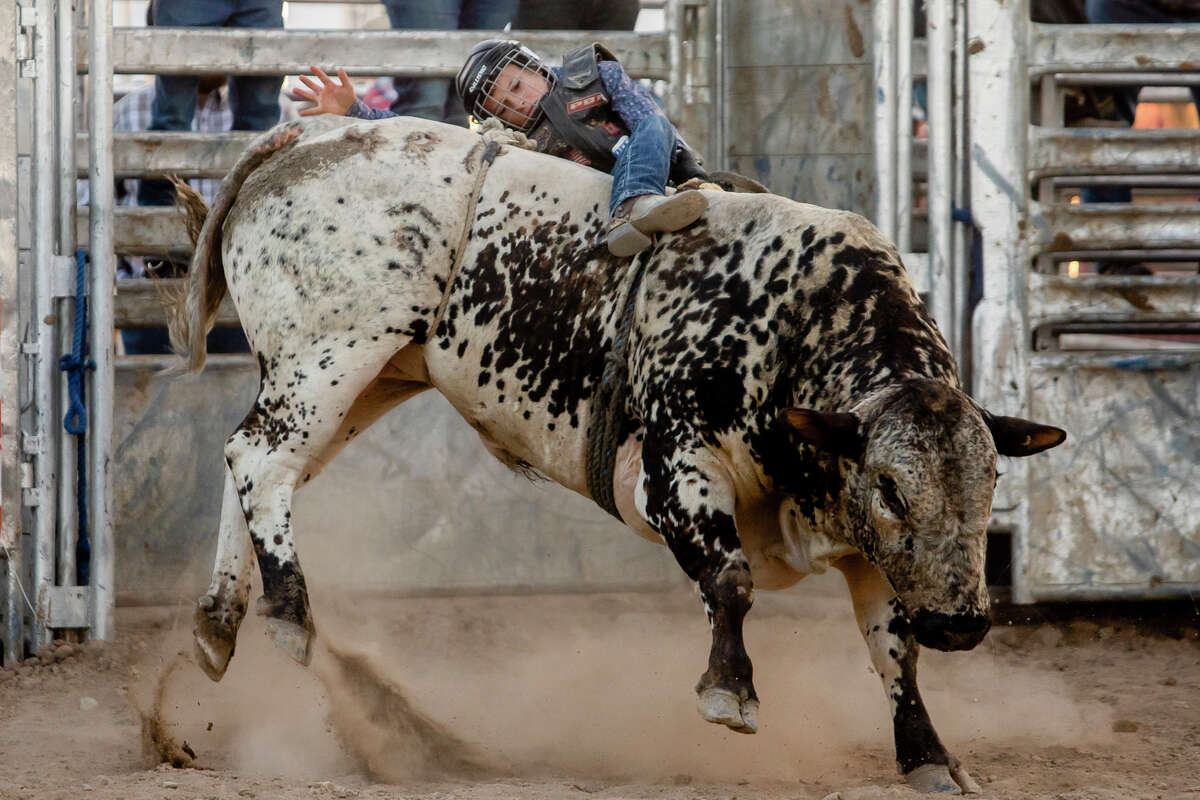 Jayson Debaeke of Houghton Lake, 12, competes in bull riding as hundreds of spectators attend the first night of the Super Kicker Rodeo Monday, Aug. 16, 2021 at the Midland County Fairgrounds. (Katy Kildee/kkildee@mdn.net)