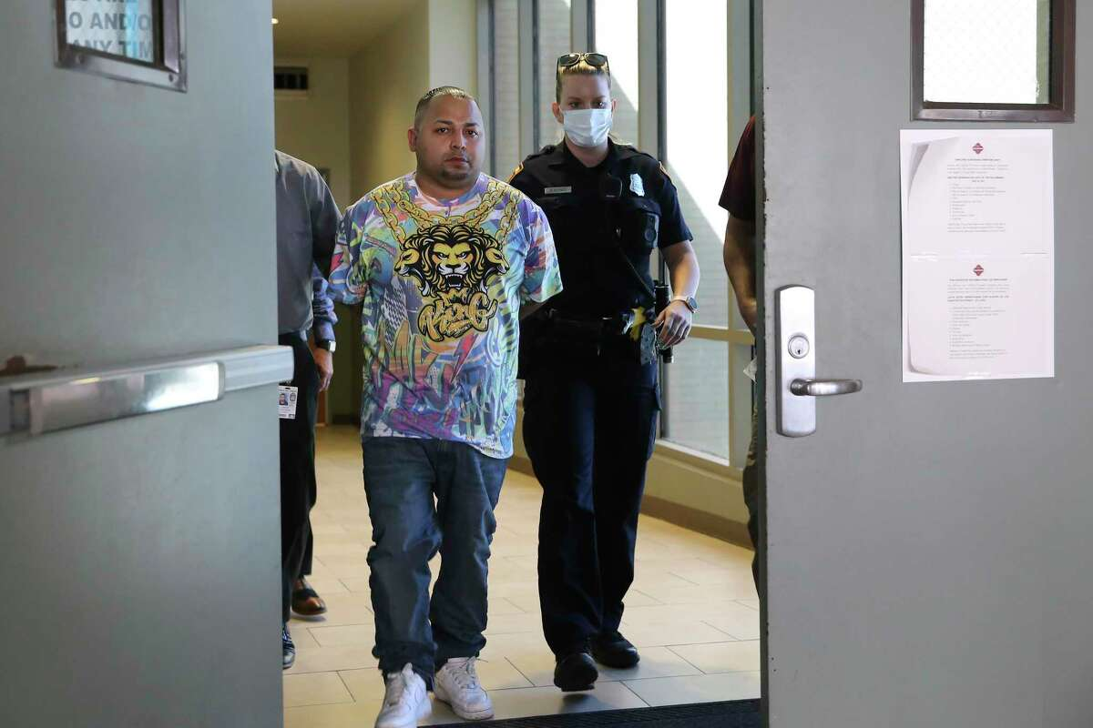 Daniel Barragan is led to the magistrates after his arrest on capital murder charges, Monday, Aug. 16, 2021. San Antonio Police Chief William McManus said Barragan is a suspect in a triple homicide at the Boom Boom Sports Bar on the 1600 block of South New Braunfels early Sunday morning.