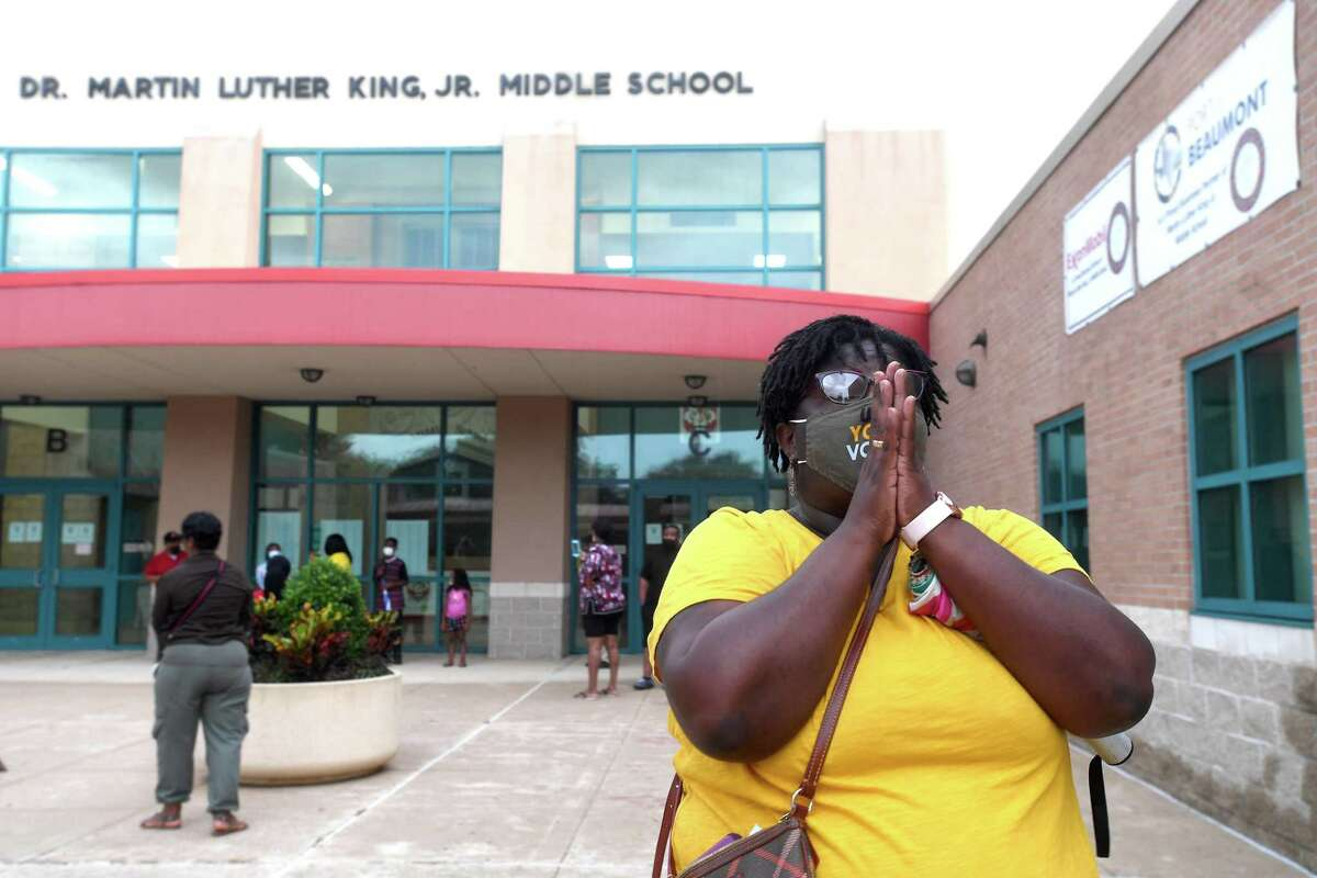 """Angela Batiste repeats, """"Thank you, Lord"""" as she joins in a prayer outside Martin Luther King, Jr., Middle School for a safe and successful school year before the start of the year Tuesday. It was amonng the 36 Beaumont schools that were covered in prayers as part of a community intitiative spearheaded by Angela Batiste. Photo made Monday, August 16, 2021 Kim Brent/The Enterprise"""