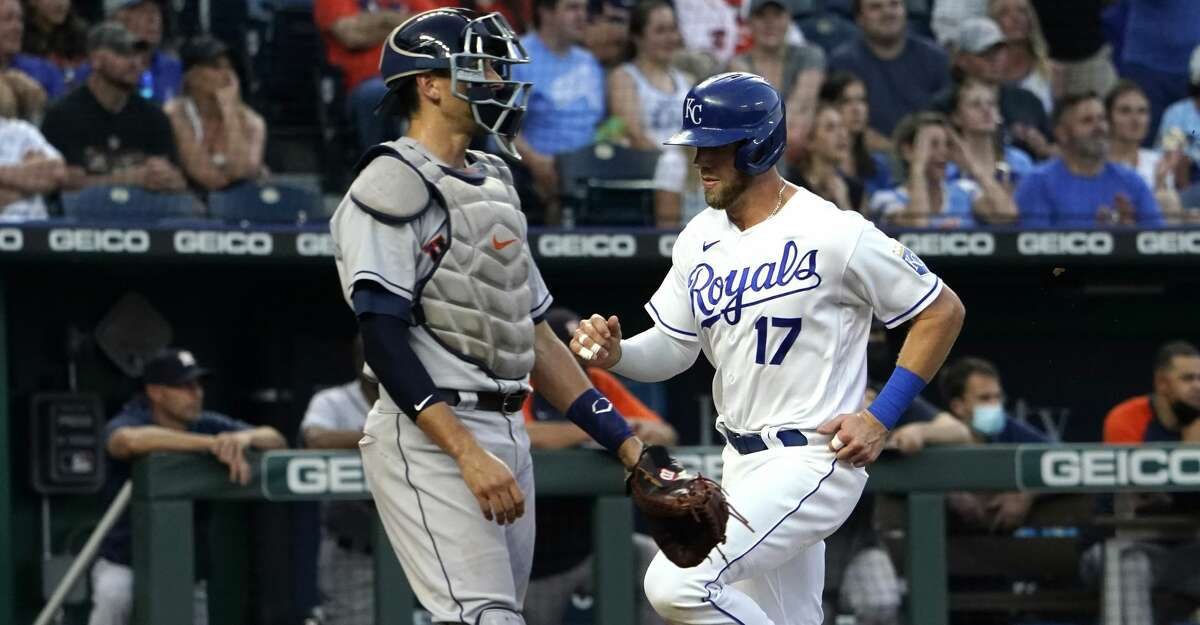 Hunter Dozier #17 of the Kansas City Royals scores past Jason Castro #18 of the Houston Astros on a Whit Merrifield single in the second inning at Kauffman Stadium on August 16, 2021 in Kansas City, Missouri. (Photo by Ed Zurga/Getty Images)