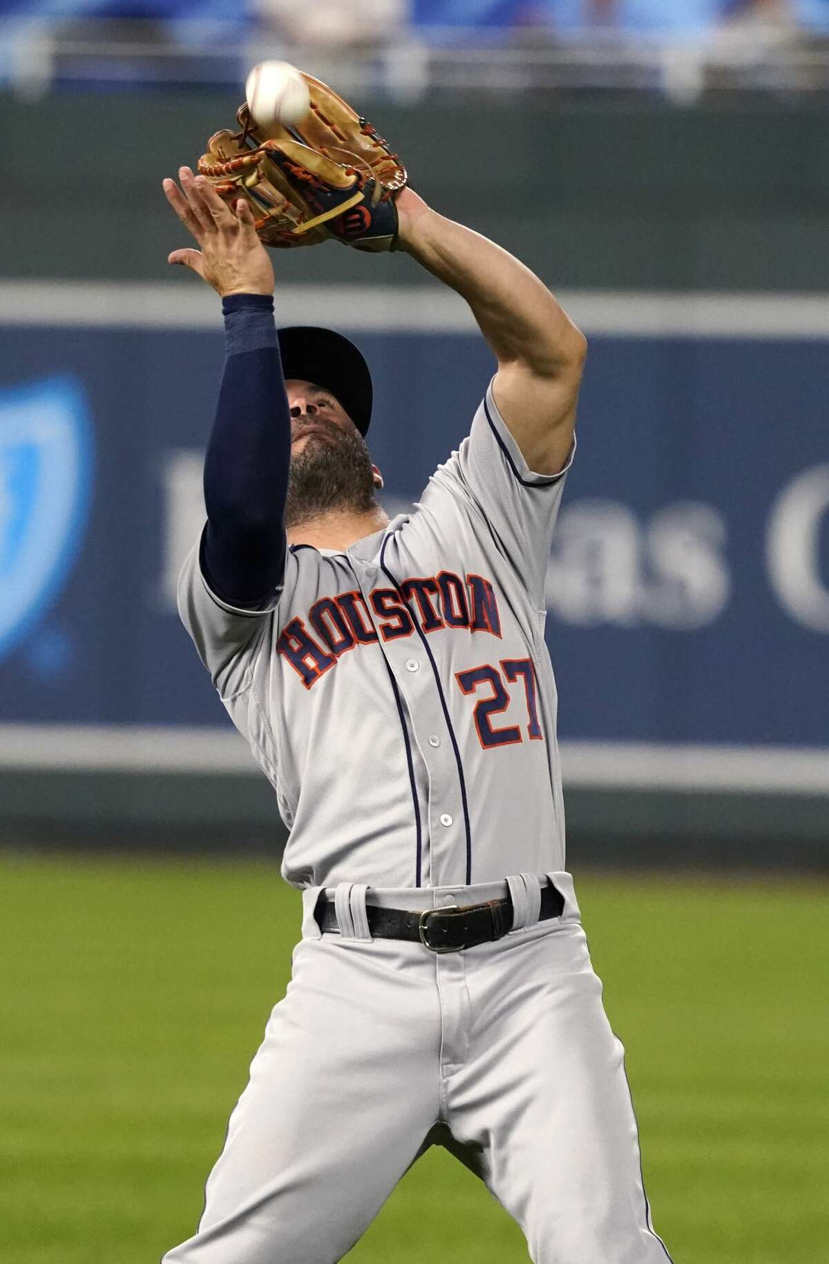 KANSAS CITY, MISSOURI - AUGUST 16: Jose Altuve #27 of the Houston Astros catches a ball hit by Whit Merrifield of the Kansas City Royals in the fourth inning at Kauffman Stadium on August 16, 2021 in Kansas City, Missouri. (Photo by Ed Zurga/Getty Images)