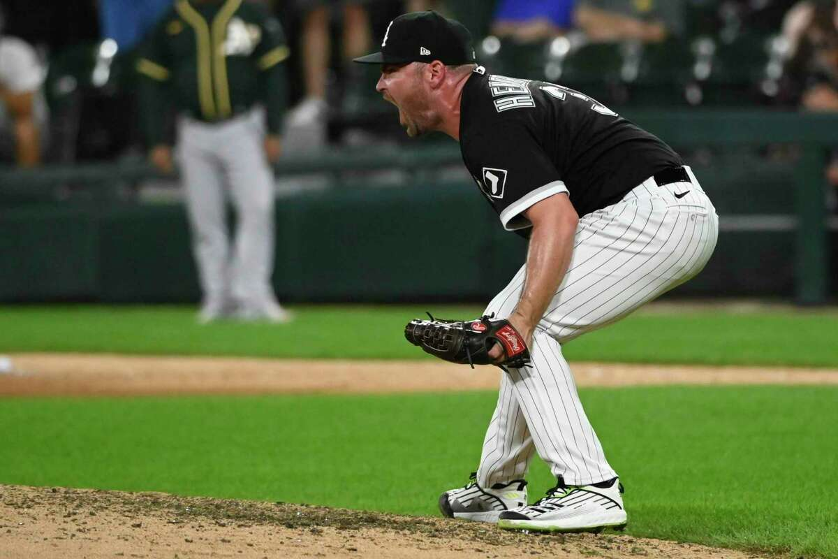 Chicago White Sox relief pitcher Liam Hendriks reacts at the end of the baseball game against the Oakland Athletics, Monday, Aug. 16, 2021, in Chicago. (AP Photo/Matt Marton)