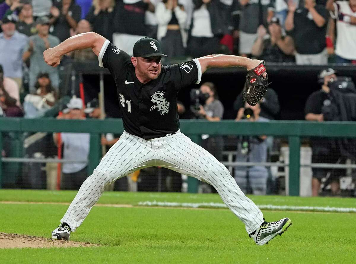 Former A's closer Liam Hendriks celebrates the game's final out after firing a 98 mph fastball past Mark Canha.