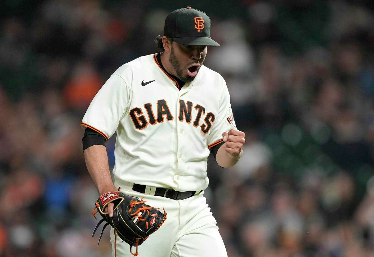 SAN FRANCISCO, CALIFORNIA - AUGUST 16: Jose Alvarez #48 of the San Francisco Giants reacts after striking out Michael Conforto #30 of the New York Mets to end the top of the sixth inning at Oracle Park on August 16, 2021 in San Francisco, California. (Photo by Thearon W. Henderson/Getty Images)