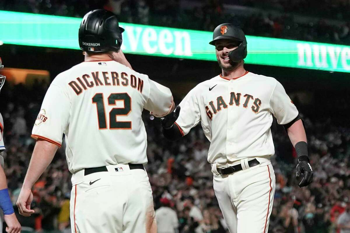 San Francisco Giants' Kris Bryant, right, celebrates after hitting a two-run home run that also scored Alex Dickerson (12) during the fifth inning of a baseball game against the New York Mets in San Francisco, Monday, Aug. 16, 2021. (AP Photo/Jeff Chiu)