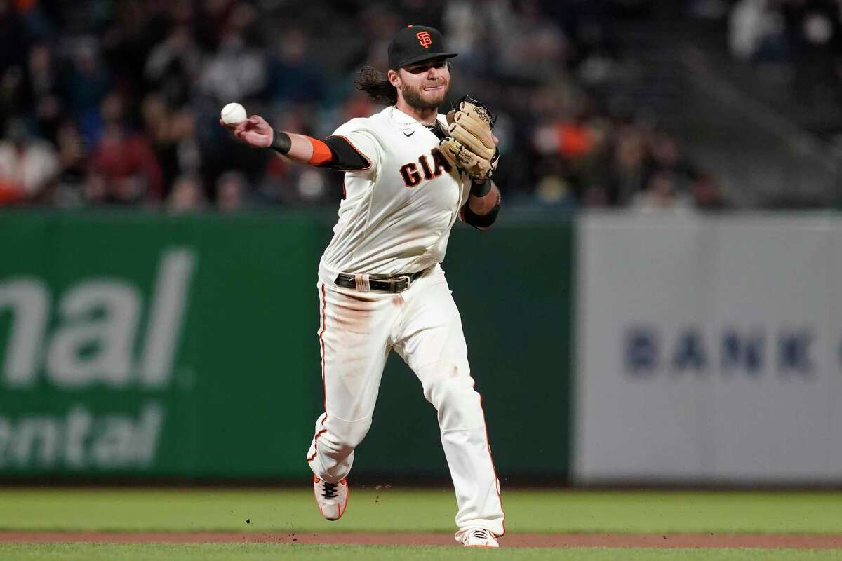 San Francisco Giants shortstop Brandon Crawford throws out New York Mets' Dominic Smith at first base during the seventh inning of a baseball game in San Francisco, Monday, Aug. 16, 2021. (AP Photo/Jeff Chiu)
