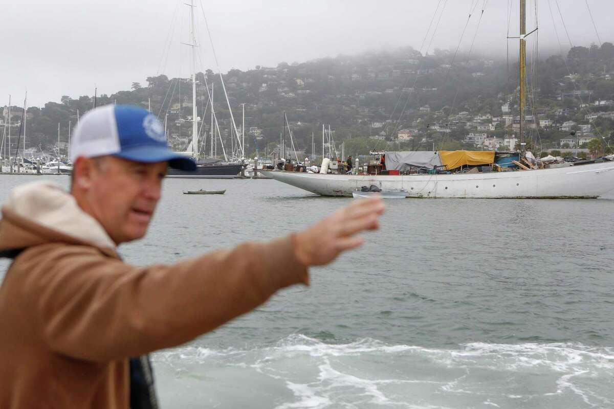 Harbormaster Curtis Havel enforces the removal of illegal vessels on the waters.