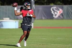 Texans quarterback Deshaun Watson throws a pass during practice on Thursday, Aug. 12, 2021 in Houston.