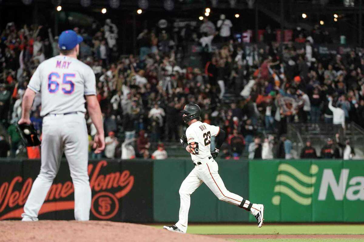 San Francisco Giants' Kris Bryant, right, rounds the bases after hitting a home run off of New York Mets pitcher Trevor May (65) during the seventh inning of a baseball game in San Francisco, Monday, Aug. 16, 2021. (AP Photo/Jeff Chiu)