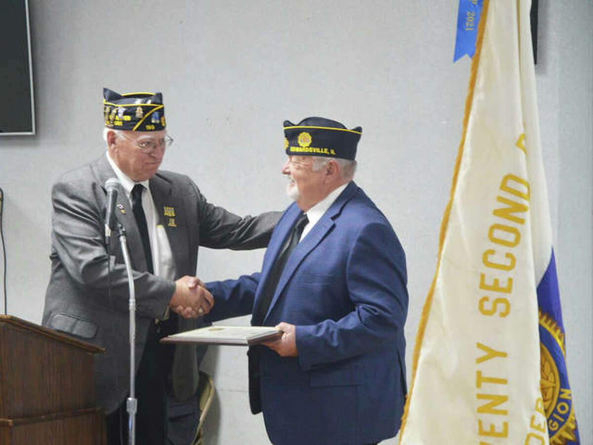 Ron Swaim, left, the new commander of Edwardsville American Legion Post 199, presents a special recognition award to retiring commander John Pinegar during Sunday's installation ceremony.