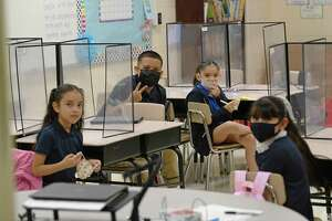 All students return to campuses across the city for their first day of school, masks encouraged and mandated, at McDonnell Elementary on Monday, August 16, 2021.