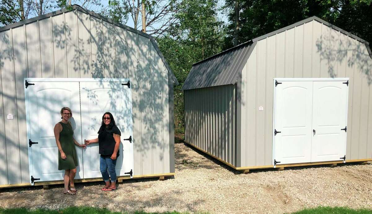 Pictured with the newly installed shed at Our Brother's Keeper Shelter is Lila Ecker, OBK shelter administrator, and Nicole Alexander, OBK executive director. (Courtesy photo)