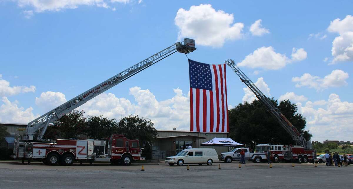 Allen Wayne Huelsebusch's funeral service on Monday at the Brenham Fireman's Training Center was attended by the Conroe Fire Department, where he retired in 2014.