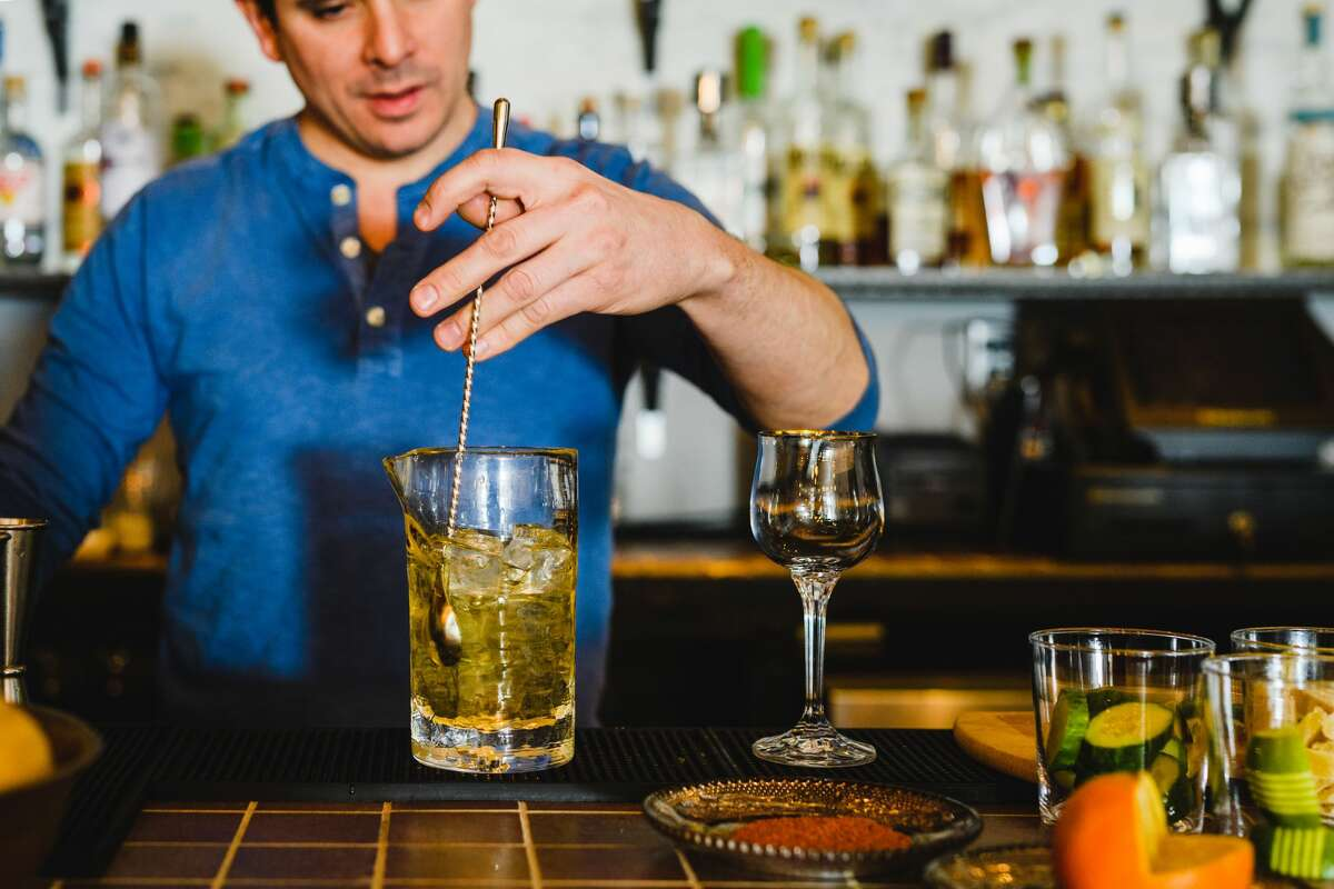 Shane McGowan stirs a cocktail at Tavern on State in New Haven