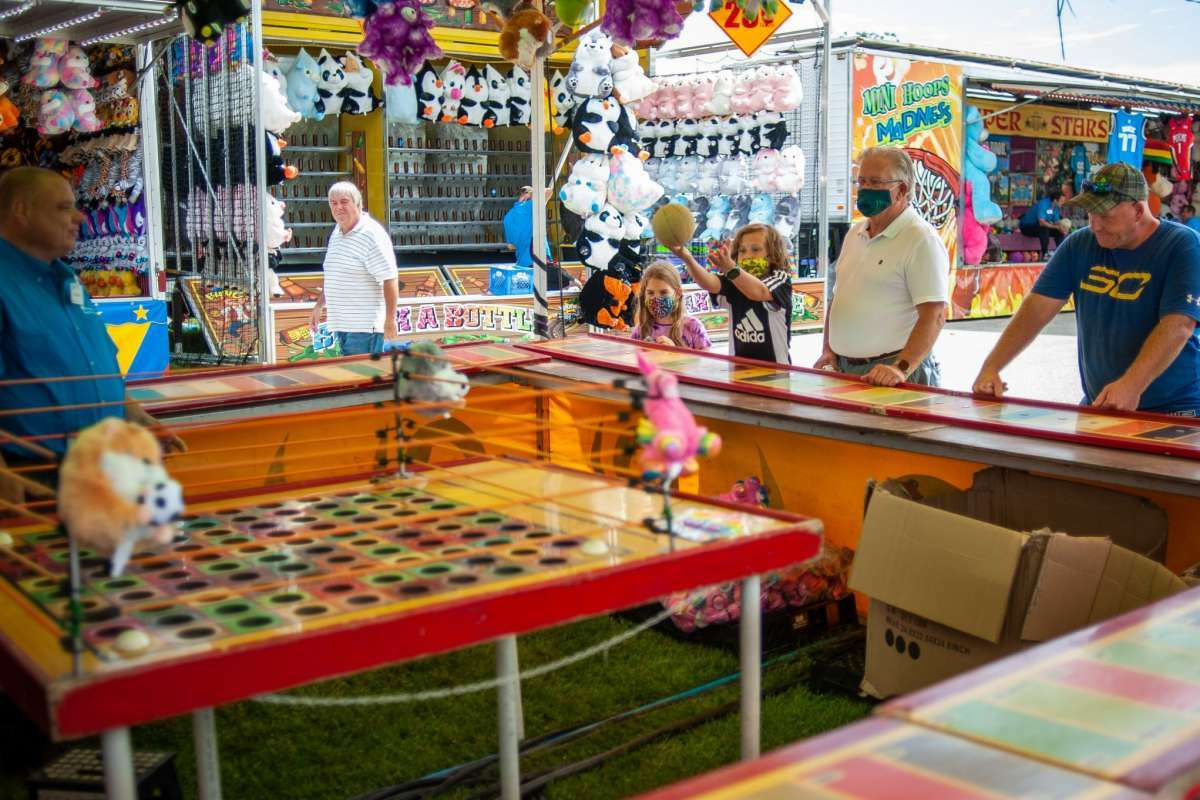 File - People enjoy games and food during the Midland County Fair on Aug. 16, 2021.