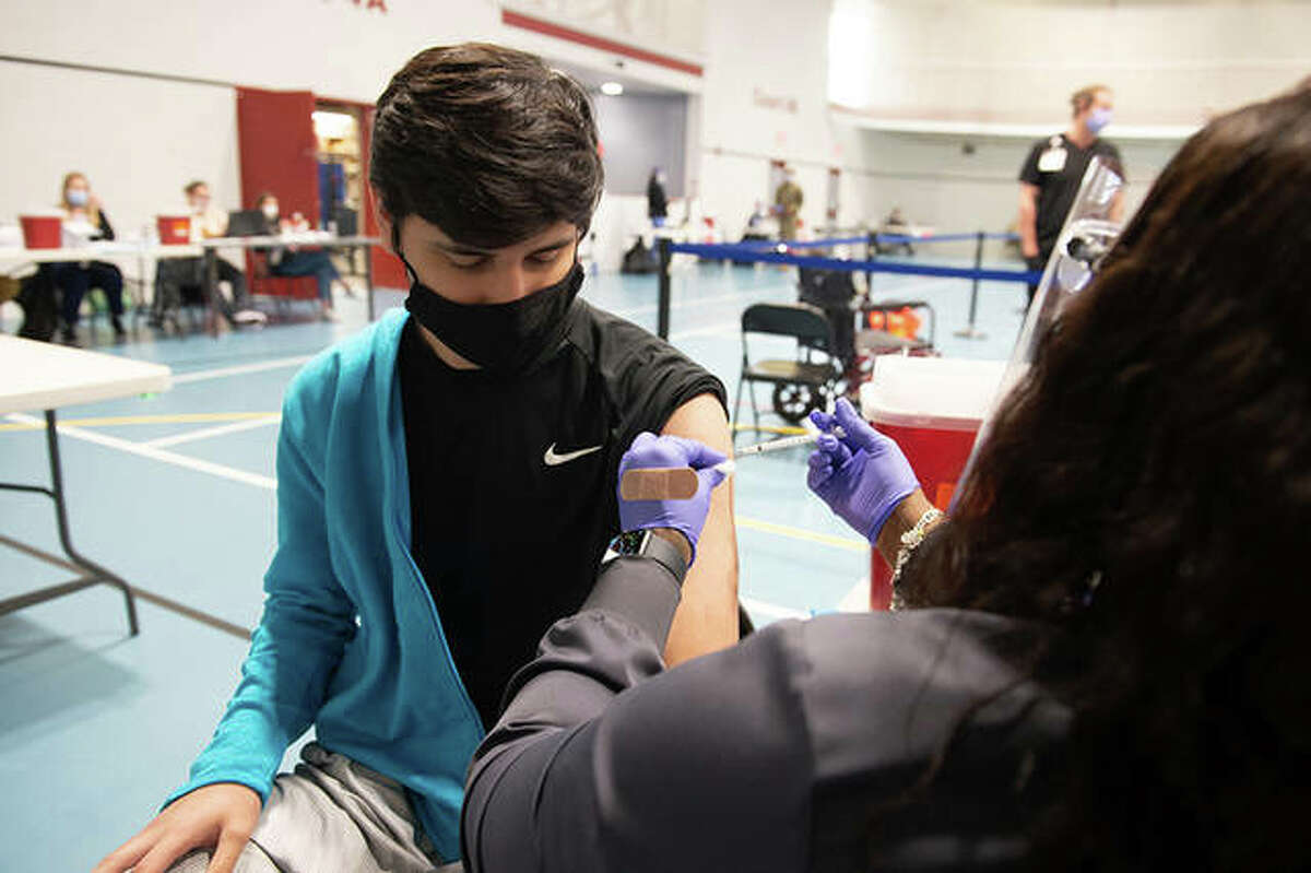 Adrian Herrera, a freshman engineering student, gets vaccinated for COVID-19 on April 21 during a clinic in the Student Fitness Center at Southern Illinois University Edwardsville.
