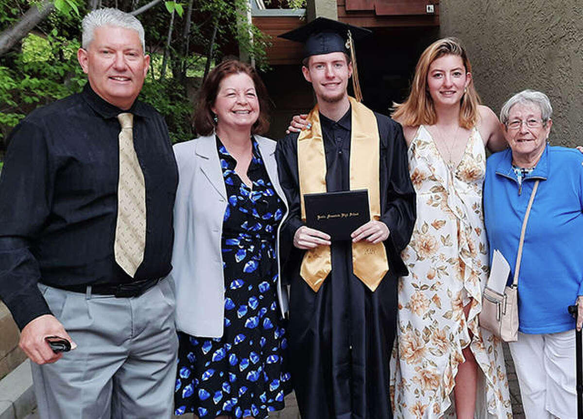 Edwardsville graduate Amy (Armstrong) Ducharme, second from left, with her family, including husband Derek Ducharme, son Harry, daughter Ashlee and Sharon Rocha, Derek's mother.