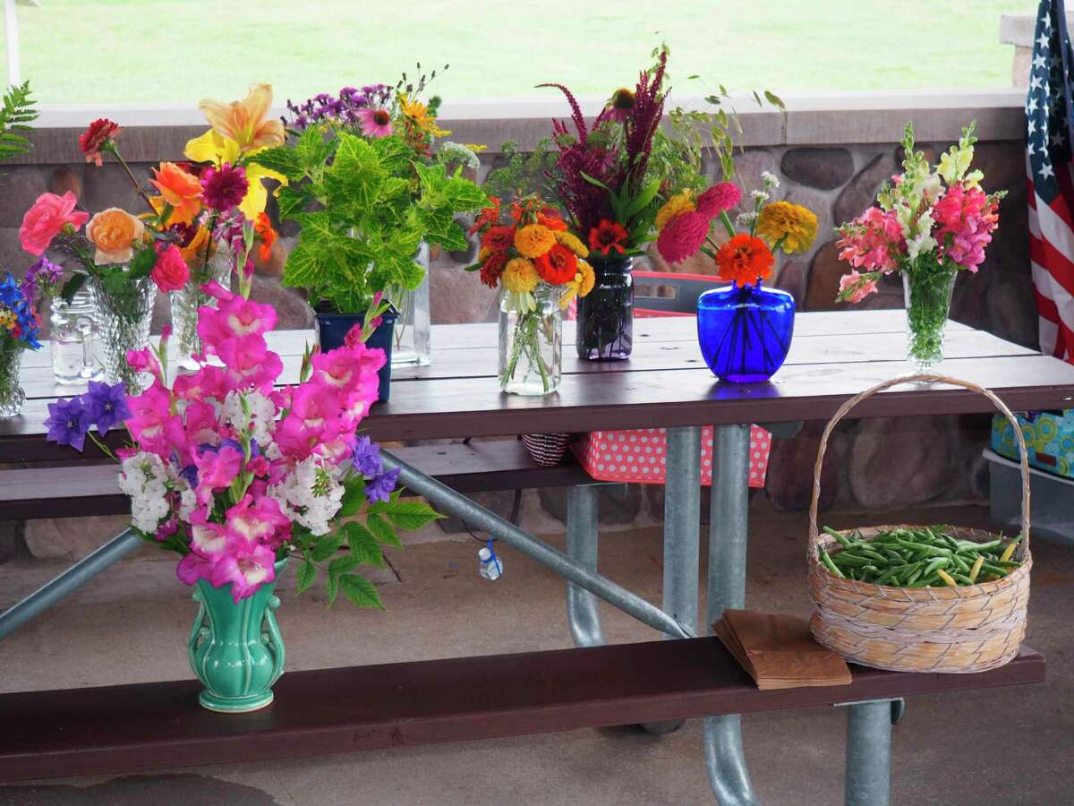 During their August meeting, members of theSpirit of the Woods Garden Clubbrought floral arrangements of flowers picked from their gardens. (Courtesy photo)