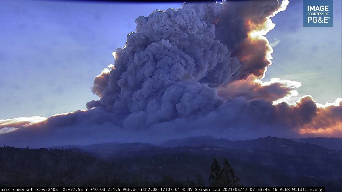 An image captured by an AlertWildfire camera showing a towering plume of smoke billowing off the Caldor Fire burning in El Dorado County.