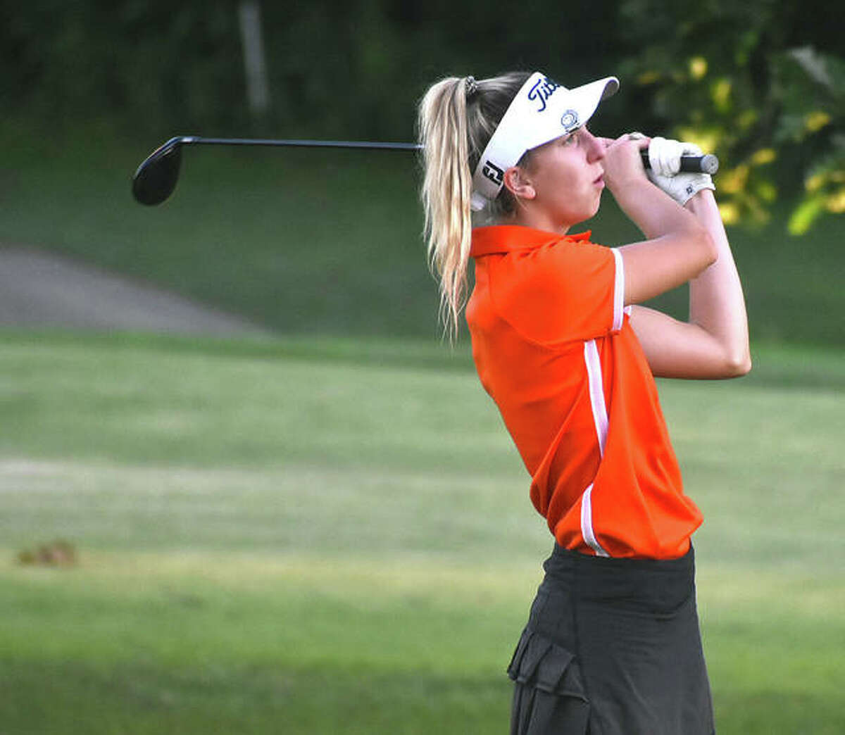 Edwardsville's Grace Daech watches her second shot on No. 4 at Woodlands Golf Club during the Alton Kick-Off Scramble/Shamble on Saturday in Alton.